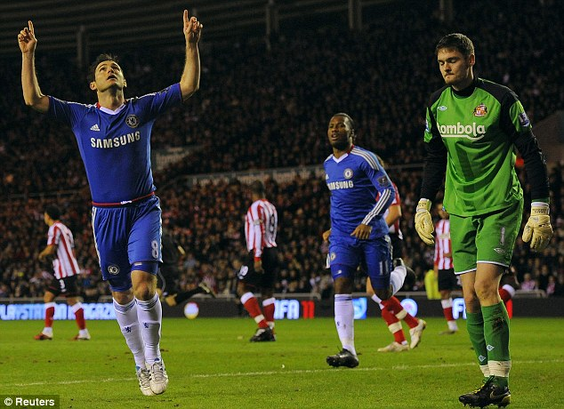 On the spot: Frank Lampard celebrates his equalising penalty