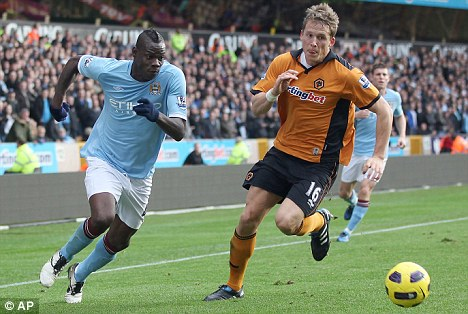 Derby delight: Balotelli (left) could be back in a City shirt when the play United