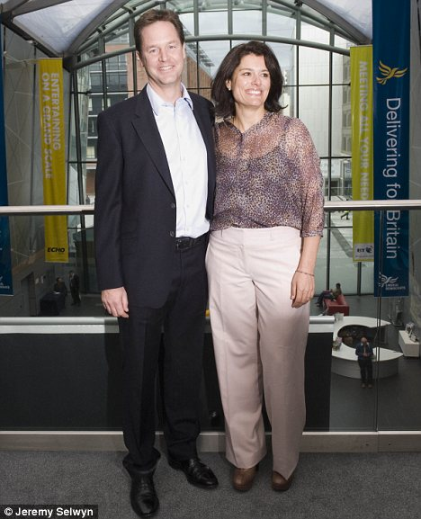 Family man: Nick Clegg and his wife Miriam. Politicians have questioned how he can do his job properly if he does not accept memos after 3pm