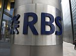 FILE - In this Friday, Aug. 3, 2012 file photo, a woman walks by an office of Royal Bank of Scotland (RBS) in the City of London.  U.S. and U.K. authorities fined the Royal Bank of Scotland more than $610 million Wednesday for its role in the manipulation of a key global interest rate ó with the bank pledging to make the rate-riggers and their managers foot the bill. (AP Photo/Sang Tan, File)