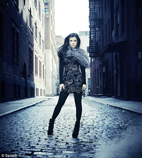 Stylish: Kourtney seen here on a cobbled side street. The new show premieres on U.S. channel E! on January 23
