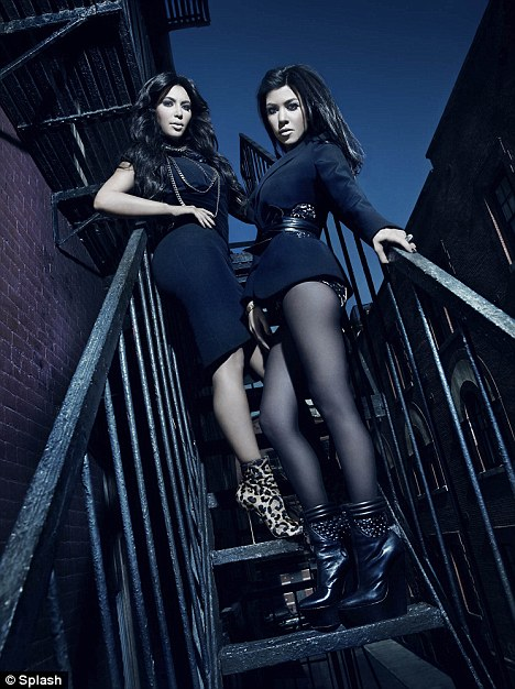 Sultry: Kim and sister Kourtney stand on the fire escape stairway of an apartment in the Big Apple where they filmed Kourtney and Kim Take New York