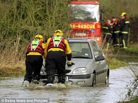 Flood risk: Two people were rescued from their cars after flooding in Ingatestone, Essex, at the weekend. Pre-Christmas snowfall and heavy rain has left the ground saturated