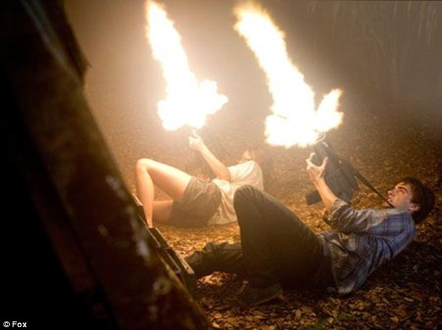 Get back! The two Shannon children open fire on something that is threatening the human colony