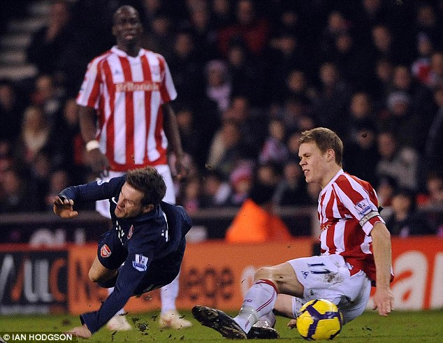 Agony: Ramsey had to battle his way back after suffering a double leg break in this challenge from Shawcross
