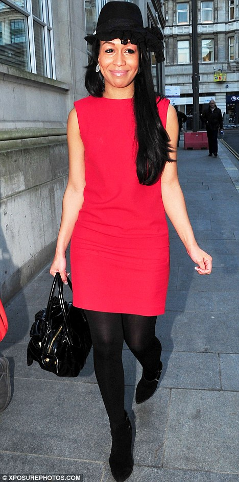 Hat's not a good look: Rebecca's scarlet dress and black shoes looked stylish - but the frilled trilby was just weird
