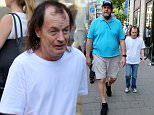 Angus Young of AC/DC and his bodyguard are mobbed by fans after a city stroll.\\n\\nFeaturing: Angus Young\\nWhere: Duesseldorf, Germany\\nWhen: 11 Jul 2015\\nCredit: WENN.com