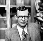 FILE - In this 1931 file photo, Clyde Tombaugh poses with the telescope through which he discovered the Pluto at the Lowell Observatory on Observatory Hill in Flagstaff, Ariz. On Tuesday, July 14, 2015, NASA's New Horizons spacecraft, carrying a small canister with his ashes, is scheduled to pass within 7,800 miles of Pluto which he discovered 85 years ago. (AP Photo)