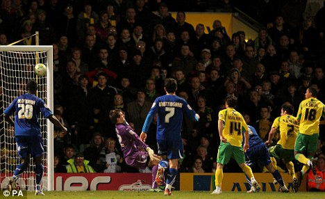 Late show: Martin (second right) scores the equalising goal