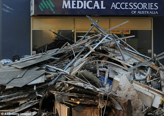 Aftermath: Debris piled up at a medical store in Brisbane.