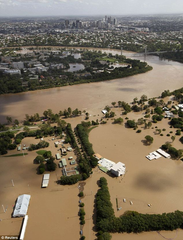 Waterlogged: The flooded Brisbane River spills into residential areas close to the city's central business district
