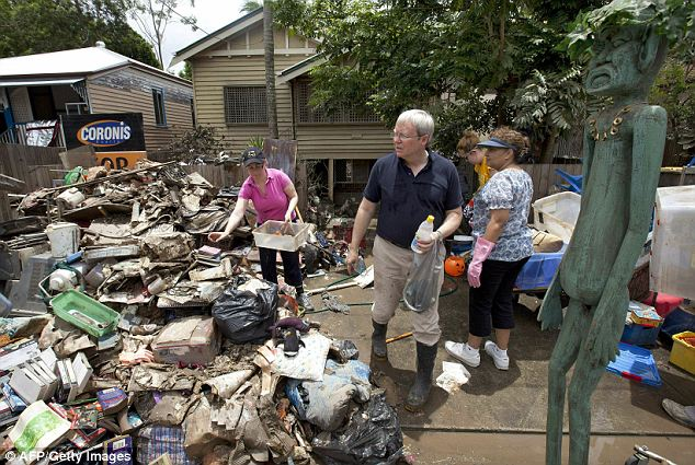 Lending a hand: Former Australian prime minister and current Australian Foreign Minister Kevin Rudd joins other volunteers in the clean-up effort