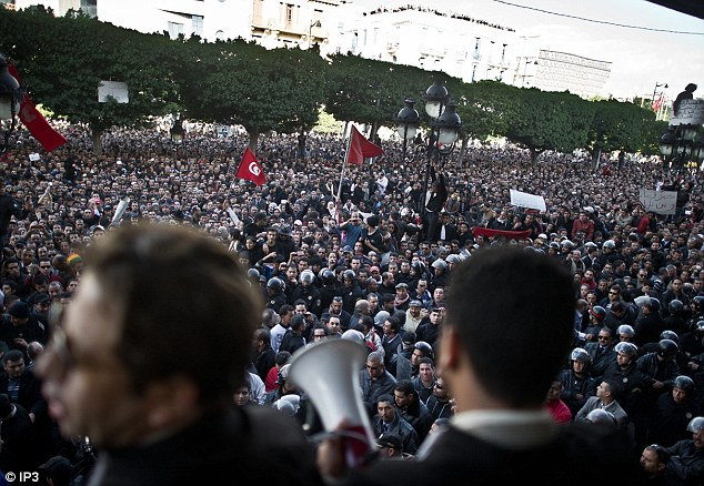Protesters attend a rally yesterday as ousted President Zine El Abidine Ben Ali dismissed his government