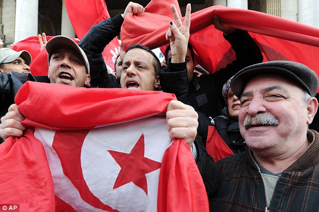 Tunisians living in Belgium joined the protest by holding a demonstration at the Brussels stock market today