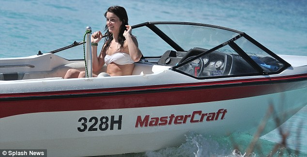 Water baby: Lucie also enjoyed a speedboat ride with friends during their luxurious holiday