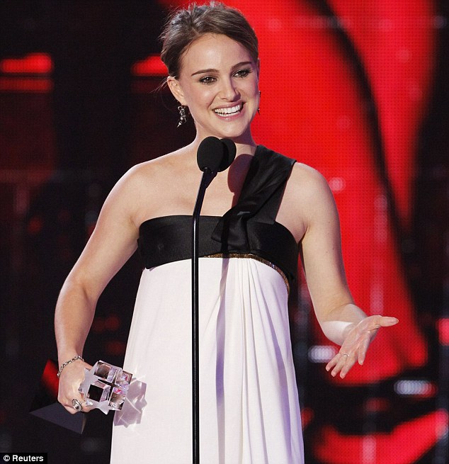 Success: Natalie Portman was thrilled as she collected the Critics' Choice Best Actress award in Hollywood on Friday night