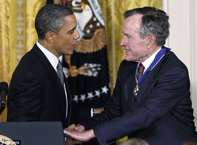 Respect: The current U.S. President speaks with former premier George H.W. Bush