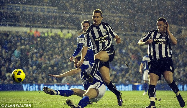Singing in the rain: Peter Lovenkrands pounces to give Newcastle an early lead