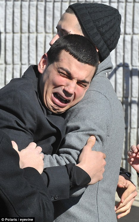 Inconsolable: Gerard Yonig breaks down after helping to carry the coffin of his girlfriend, Yelena Bulchenko, who was killed in a stabbing spree last week