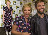 """Cast members Toni Collette and Adam Scott pose at a press line for """"Krampus"""" during the 2015 Comic-Con International Convention in San Diego, California July 11, 2015. REUTERS/Mario Anzuoni"""