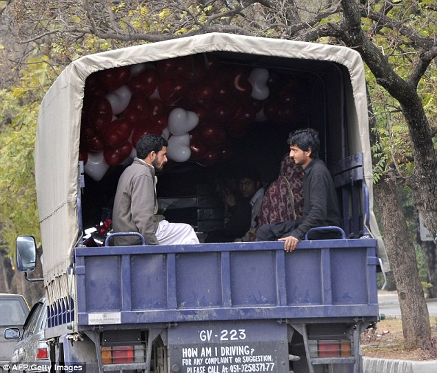 Pakistani police transport detained roadside balloons vendors on St. Valentine's Day in Islamabad on February 14, 2011.