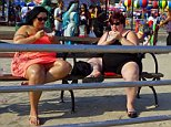 Two overweight women Eating ice cream Coney Island  Decisive moment