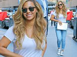 BeyoncÈ is all smiles while carrying her MacBook Pro while out and about in New York City, the singer was wearing just a white t-shirt and jeans  on Jul 13, 2015\n\nPictured: BeyoncÈ\nRef: SPL1078314  130715  \nPicture by: Felipe Ramales / Splash News\n\nSplash News and Pictures\nLos Angeles: 310-821-2666\nNew York: 212-619-2666\nLondon: 870-934-2666\nphotodesk@splashnews.com\n