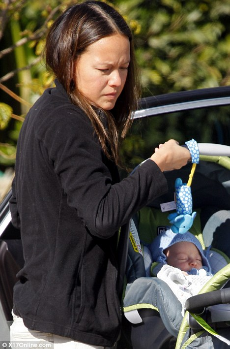 New mother: Jade carried baby Robert in his car seat as she arrived at the house on Monday