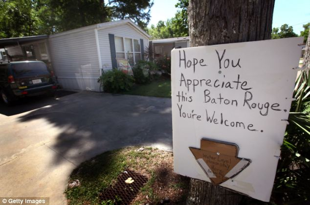 Parting message: A resident in the small town of in Butte LaRose, Louisiana, leaves a message for Baton Rouge. The town, and many more like it, has been evacuated ahead of rising water from the Morganza Spillway