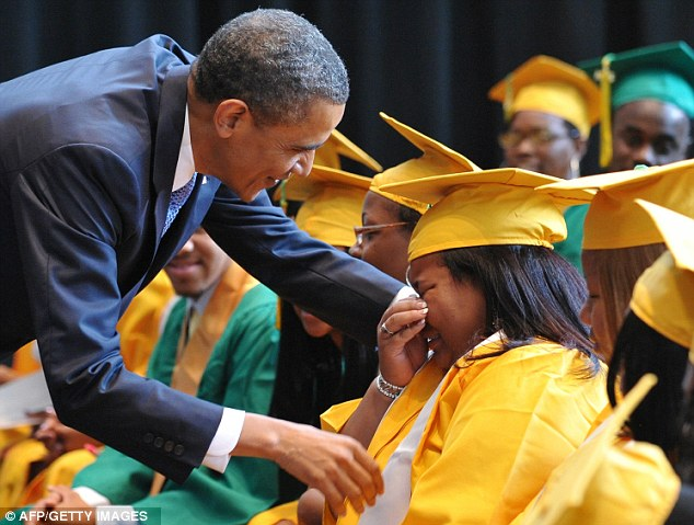 Tearful: President Obama greets graduating students before the Booker T. Washington High School graduation ceremony today during his tour in Memphis, Tennessee. The school won this year's Race to the Top High School Commencement Challenge