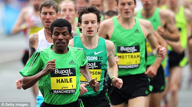 Look out behind you: Chris Thompson (centre) trails Haile Gebrselassie