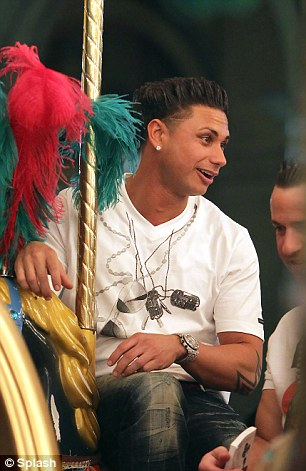 Gang: On the weary side was 24-year-old Deena Nicole Cortese, who leaned up against the ride for support while Paul 'Pauly D' DelVecchio grinned from ear-to-ear
