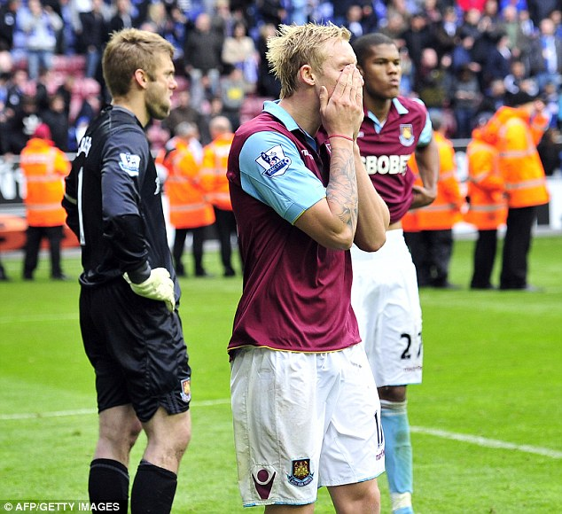 Crashing down: Jack Collison looks distraught as the news sinks in of West Ham's fate