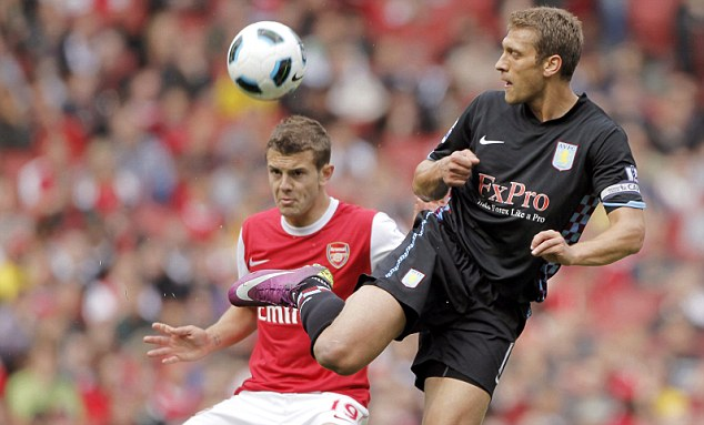 Eyes on the ball: Arsenal's Jack Wilshere challenges Stiliyan Petrov