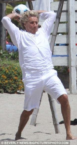 Eye on the ball: Avid football fan Rod  tried out his ball skills on the beach