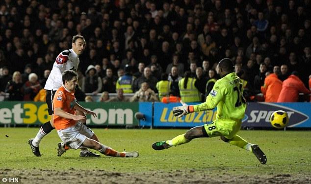 Pure drama: Dimitar Berbatov scores Manchester United's winner at Blackpool