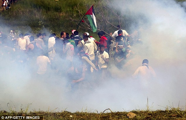 Violence: Eight people have been killed after clashes erupted along the Israel border with Syria