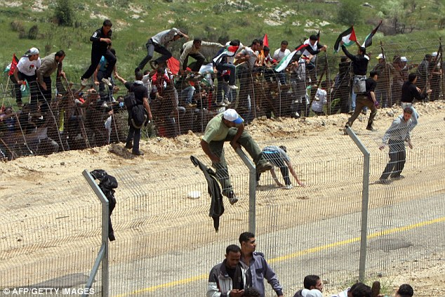 'Staged': Israel accused the Syrian government of deliberately allowing protesters near the border line to detract from problems within the country