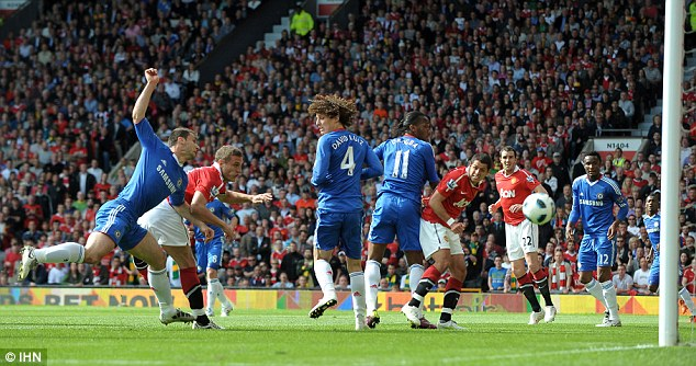 Giving Chelsea the Blues: Nemanja Vidic scores during United's crucial recent victory at Old Trafford