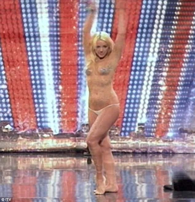 Are you ready: Lorna throws her arms up, revealing her see-through bodysuit, as she launched into her performance