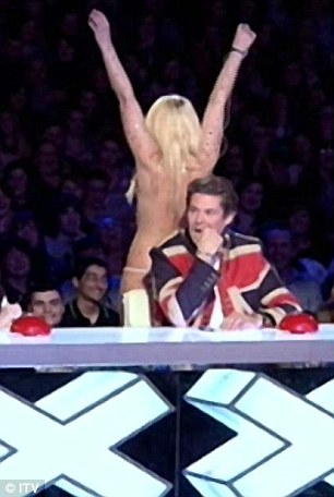 What's she doing? Hasselhoff doesn't know where to put himself as Lorna wiggles up and down behind him