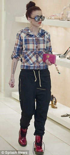 Trendy: Cher, seen earlier this month, has managed to fit in various shopping sprees during her time in America