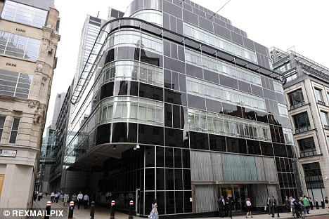 Outrage: Goldman Sachs has handed out nearly £10bn in bonuses to its staff - yet cut the amount it gives to charity by more than a third