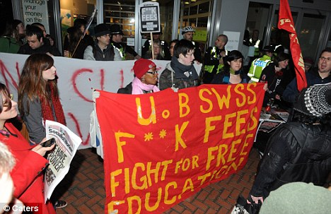 Protests: The announcement of city bonuses caused anti-banker protests, including these in Birmingham, when at least 50 people stormed a branch of Lloyds TSB in the city