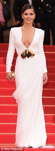 Revealing: The dress was rather more modest than the one she had sported earlier for the film showcase itself - a plunging white Stephane Rolland gown that left little to the imagination