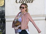 """Beverly Hills, CA - """"Sparks"""" songstress Hilary Duff got in some shopping in Beverly Hills on Monday morning, accompanied by a gal pal. The 'Younger' actress donned a white tank, leggings, sneakers, and a pale pink leather jacket as she first browsed Cartier before heading to Sephora for a few makeup essentials. AKM-GSI     July 13, 2015 To License These Photos, Please Contact : Steve Ginsburg (310) 505-8447 (323) 423-9397 steve@akmgsi.com sales@akmgsi.com or Maria Buda (917) 242-1505 mbuda@akmgsi.com ginsburgspalyinc@gmail.com"""