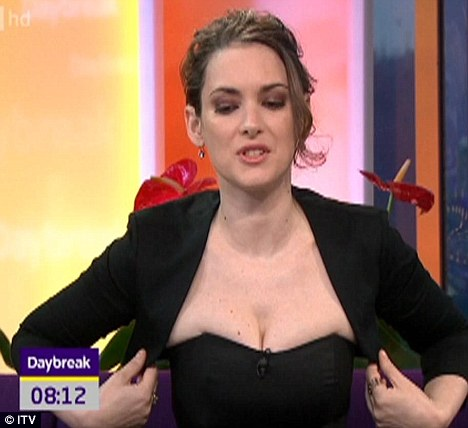 Painful: Winona appeared to be struggling as the corseted top dug into her chest