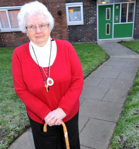 Joyce Burt, 90, was able to go outside - having been stranded by snow in her home for over a week - after Michael Lander cleared the path