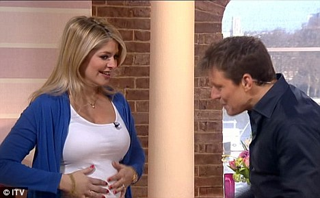 Blooming marvellous: Ben Shephard initially complimented Holly Willoughby on her growing baby bump on This Morning