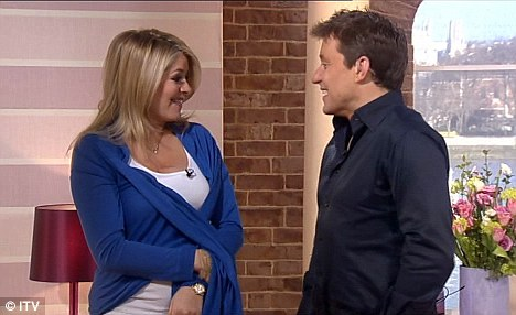Embarrassed: Holly quickly moved to cover herself with her cardigan after Ben made his comments